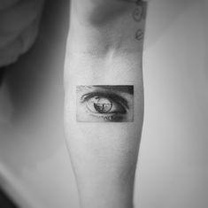 Amazing eye tattoo on arm by @balazsbercsenyi