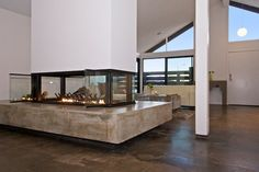This modern residence in the desirable Costa Mesa neighborhood of Mesa Verde North was completely re-imagined by professional designer Kristine Hedley and remodeled by the current owner with over $200,000 in custom upgrades. The floor plan has been opened to create more light and sense of space, highlighted by a dramatic four sided glass fireplace that connects the family room and kitchen areas to the spacious front living room.