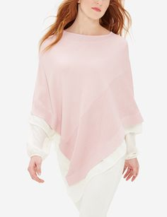 The trendy poncho, with a feminine flair! Wear this romantic piece with boyfriend jeans for an easy everyday look that dazzles.