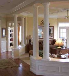 Open floor plan, but use pillars when you need support - good idea for the space between the foyer and the sanctuary