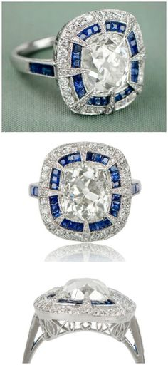 A sapphire and diamond antique engagement ring, with a 4.98 carat cushion cut center diamond in platinum with French cut sapphires and filigree detailing.