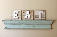 EAT Sign on Reclaimed Wood with Dimensional Painted Metallic Letters. $75.00, via Etsy.