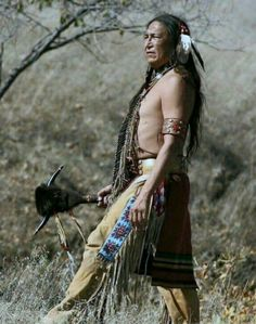 A Native American Indian man standing with a weapon with horns Native American Pictures, Native American Beauty, Indian Pictures, American Indian Art, Native American History, Guy Pictures, American Pride, American Indians, American Spirit