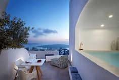 Not sure, where to stay in Santorini? Check these 10 stunning hotels and find the best place to stay in Santorini for your romantic getaway! Best Hotels In Santorini, Fira Santorini, Fira Greece, Greece Trip, Mykonos, Dana Villas, Interior Design Photography, Next Holiday, Amazing Spaces