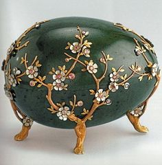 This Kelch egg of 1901 called the Apple Blossom Egg was larger than most of the other Faberge eggs, and was designed as a jewelry case.  The surprise that went with it was later lost.  It was made with nephrite, gold, silver, diamonds and velvet.