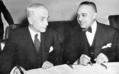 "Some of the key figures and moments from FDR's ""Good Neighbor Policy."" In this picture, U.S. Secretary of State and Rafael Trujillo, dictator of the Dominican Republican, signing a treaty. As Europe fights against dictatorships, the U.S. was willing to work with those that showed friendly attitudes toward the U.S."