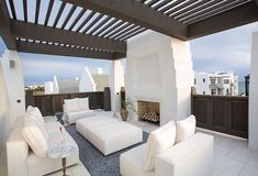 Fireplace, white decor, coastal design Rooftop terrace in Alys Beach