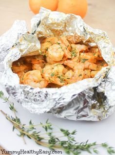 Orange-Thyme Grilled Shrimp is cooked in foil packets and is oh-so-easy! The orange and garlic flavors infuse the shrimp, making them juicy, flavorful.