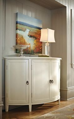 This curved cabinet is ideal for that empty nook in the dining room. When guests are over, create a small buffet  on it for desserts or appetizers. HomeDecorators.com