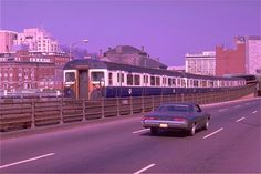 1950's MBTA Red Line train in MA state colors crossing the Charles, Boston, MA