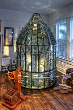 """Barnegat, NJ 1st Order Fresnel Lens    A standard 1st Order Lens is 6'1"""" in Diameter and 7'10"""" Tall and weighs 12,800 lbs and very lovely. The rate of turning and the number of bulls eye lenses gave the tower it's identifying flash rate for the light. This is the origional lens. They replaced the lens in the lightgouse with a new one in 2008 that was made in New Zealand and cost $15,000."""