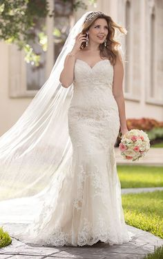 Stella York 6220 | Fit and flare gown adorned with lace applique and stunning beading. Found at New York Bride & Groom in NC