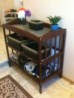 Our repurposed change table turned front entrance storage. Thanks for the inspiration pinterest!