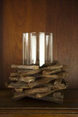 I have so many plain candle holders, this is a beautiful way to give them a rustic look.