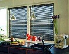 Venetian Blinds are a great choice for your kitchen, especially in aluminium. They are easy to clean and look fantastic!
