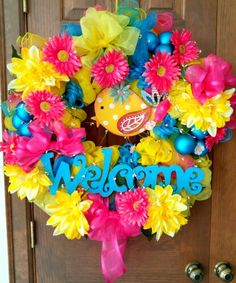 Welcome guests to your home or cottage with this large, brightly colored welcome wreath.  Vivid pink, turquoise, and yellow are perfect for spring, Easter, and summer months.   Dimensions:  30 inches diameter by 10 inches deep.  Spring and summer deco mesh, surrounding adorable painted metal chick, covered in premium wired ribbon bows and a festive abundance of large silk flowers.  $120