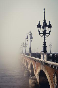 Pont de pierre dans le brouillard Bordeaux, France                                                                                                                                                      More