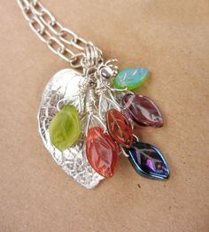 Cute idea.  I've got some of these leaf beads in my stash.  Pewter leaf pendant necklace with multicolored by MadMamaMiller