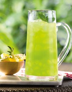 Tropical Punch with Malibu, Midori, lime and pineapple juice... YUM