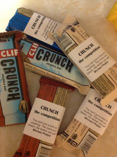 "Swim team treats.  ""Crunch the competition!"" And I included a Michael Phelps quote. Used Cliff Crunch Bars."