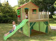 outdoor playhouse with curtains around bottom half-perfect for hiding outdoor toys like bikes