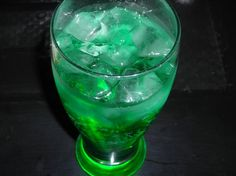 Emerald City:  Coconut Rum-1 shot, Blue Curacao-1/2 shot,  Melon Liquor-1/2 shot, Splash of Sour Mix,  Splash of Lemon Lime Soda
