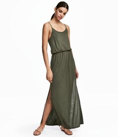 Khaki green. Long, sleeveless jersey dress with narrow shoulder straps. Elasticized seam at waist. Unlined.