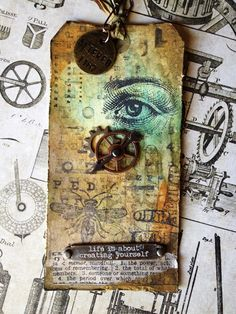 There is a video showing you how to make with tag and the different techniques Tim Holtz uses to get these different looks...