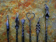 Hand forged fire pokers ,by Harry Rice