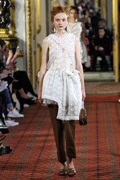 asymmetrical minidress gets tempered for daytime with a pair of crisp trousers. #refinery29 /simone-rocha-dresses-over-pants-fashion-week-spring-2016