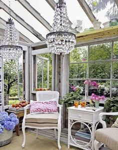The crystal chandeliers are just for show — no wiring — but what a dazzling effect! LOVE this #countryliving #dreamporch