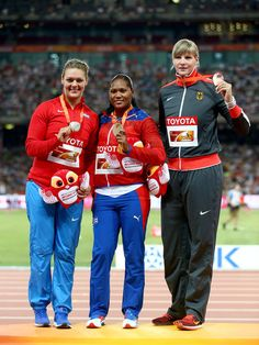 (L-R) Silver medalist Sandra Perkovic of Croatia, gold medalist Denia Caballero of Cuba and bronze medalist Nadine Muller of Germany pose during the medal ceremony for the Women's Discus final during day four of the 15th IAAF World Athletics Championships Beijing 2015 at Beijing National Stadium on August 25, 2015 in Beijing, China.