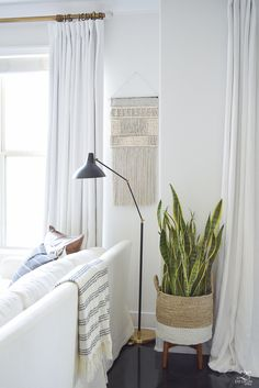 Fall Home Tour macrame wall hanging snake plant in basket on stand white linen curtains brass rod with crystal ball finials-1