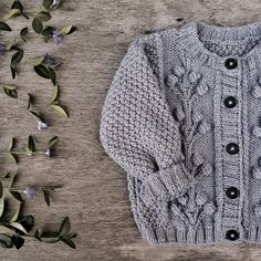 Knitted cardigan for children. The author cardigan Ayueva Marina. Pattern can be bought on Ravelry Romper Pattern, Crochet Cardigan Pattern, Knit Cardigan, Knit Crochet, Creative Knitting, Knitting For Kids, Crochet For Kids, Crochet Baby Sweaters, Knitted Baby Clothes
