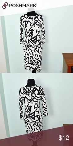 Super Cute Black Doodle Print Dress In excellent condition! Very comfortable, stretchy, and lightweight! Buy 3 items and get 1 free plus 15% off your purchase total! Dresses Midi