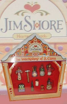 """Jim Shore Heartwood Creek Christmas Collection  Heartwood Creek Santa's Workshop Hanging Ornament  Set of 10    Most approx 1.5"""" high  Stone Resin /Jute Rope/Paper  Note: Unique variations should be expected; hand painted.    RETIRED    Your Price: $19.50"""