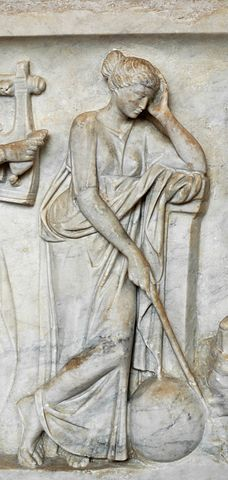 """Urania, muse of astronomy, ponting to a globe with a stick. Detail from the """"Muses Sarcophagus"""", representing the nine Muses and their attributes. Marble, first half of the 2nd century AD, found by the Via Ostiense."""