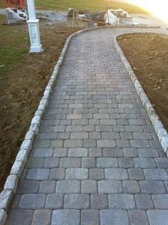 Pavestone Plaza Squares & Recs with Cobble Stone border | Yelp