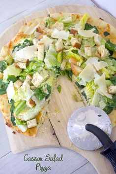 Caesar Salad Pizza -- Thin crust pizza topped with Caesar salad, cheese, and baby spinach | wearenotmartha.com