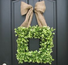 boxwood wreath with burlap bow by leila