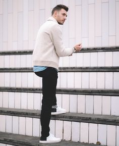 I love this mens outfit, I am wearing a wool mens bomber jacket with a pale navy denim shirt, then I am wearing simply denim jeans and white sneakers - my top mens fashion advice is look the for details, my sneakers had a green streak on the back which elevates a simple pair of shoes.
