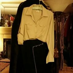 Outfit: blouse and jeans Beige poly blouse .Sleeves roll up anchor with button. Black jeans with beige trim outside seam. Ralph Lauren  Jeans Straight Leg