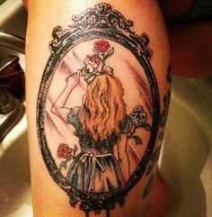 I have seen MANY Alice in wonderland tattoos but not this one. Very original!!