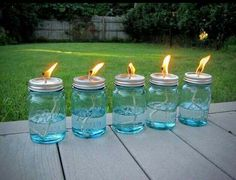 Mason jars + cotton string + liquid citronella = Let the string soak for 10-15 minutes before lighting up. No more mosquitoes!