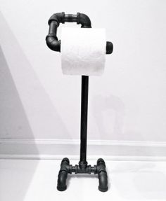 industrial-toilet-paper-holder-stand-made-from-unfinished-unless-otherwise-requested-black-iron-pipe-fittings-with-a-natural-gunmetal-color.jpg (287×350)