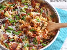 Smoky BBQ sauce, salty bacon, and creamy Monterrey Jack cheese come together in this quick one skillet pasta dish. Step by step photos.