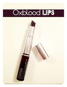 Oxblood Lips. I really wonder if I could pull off this look...black honey almost lipstick has been a staple in my bag since the mid-90s. Perfect color!