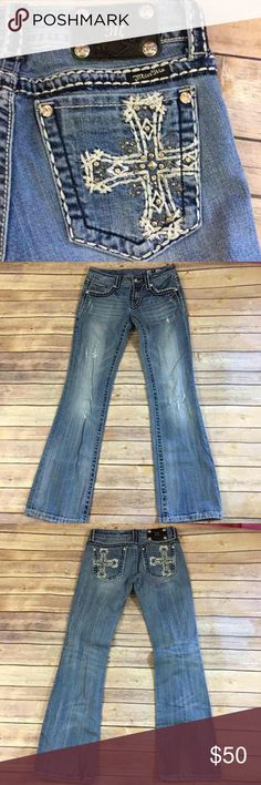 Miss Me Boot Cut Distressed Jeans Cross Pocket 28 Miss Me Boot Cut Distressed Jeans Cross Pocket JP5100U-2R  A little bit of wear to the back hem but not a lot.  A few small stick on rhinestones are missing and some threads are a little loose as tends to happen with the Miss Mes.  These are factory distressed.  Very little pulling at saddle.  So cute! Miss Me Jeans Boot Cut