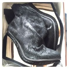 Jeffrey Campbell Xanadu Fur Boots Near mint condition Jeffrey Campbell Xanadu Pony Fur Boots with futuristic metal plating and cut-out heel detail. Worn once indoors. Very hard to find online. Fur/Leather/Metal - Size 9M Jeffrey Campbell Shoes Ankle Boots & Booties