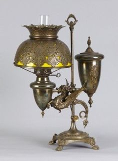 Learn more about Victorian Brass Winged Griffin Single Student Lamp available at Cottone Auctions. Victorian Desk Lamps, Victorian Lighting, Victorian Furniture, Victorian Decor, Antique Lighting, Antique Furniture, Antique Oil Lamps, Vintage Lamps, Objets Antiques